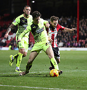 Huddersfield Town defender Ben Chilwell stopping Brentford midfielder Alan Judge during the Sky Bet Championship match between Brentford and Huddersfield Town at Griffin Park, London, England on 19 December 2015. Photo by Matthew Redman.