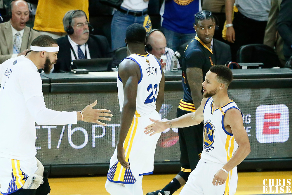 04 June 2017: Golden State Warriors center JaVale McGee (1) congratulates Golden State Warriors guard Stephen Curry (30) as Golden State Warriors forward Draymond Green (23) stares at Cleveland Cavaliers guard Iman Shumpert (4) during the Golden State Warriors 132-113 victory over the Cleveland Cavaliers, in game 2 of the 2017 NBA Finals, at the Oracle Arena, Oakland, California, USA.