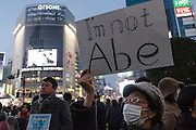 """A woman holds a sign reading """"I am not Abe"""" as people gather in silent vigil to honour hostages, Kenji Goto and Haruna Yukawa, who were murdered by ISIS terrorists in Syria in January. Shibuya, Tokyo, Japan Sunday February 8h 2015. Over 100 people gathered in Shibuya's famous Hachiko square at 5pm to hold a silent prayer vigil for the Japanese hostages and Jordan pilot. The vigil ended at 7:30pm with a small candle-lit shrine. Friends of the hostages were in the vigil and promised that all flowers and messages would be delivered to relatives."""