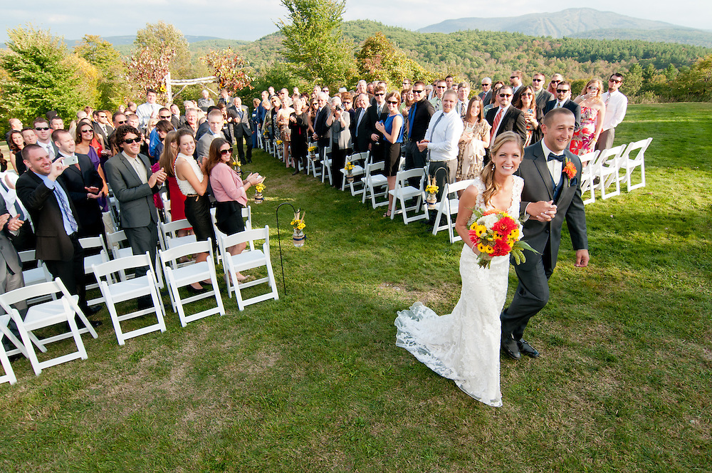 A bride and groom leave their ceremony at the Dexter Inn, Sunapee, NH.