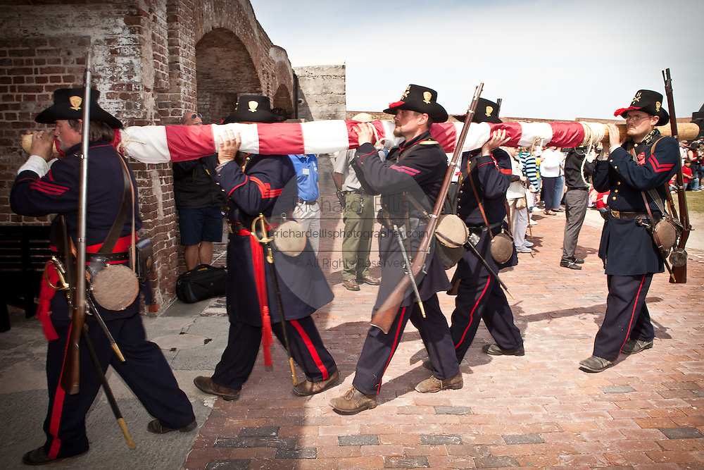 Union Re-enactors march out of Fort Sumter with the US Flag on the 150th anniversary of the surrender of the fort in the US Civil War on April 14, 2011 in Charleston, South Carolina.  The surrender of the fort marks the end of a week long commemoration of the start of the Civil War.