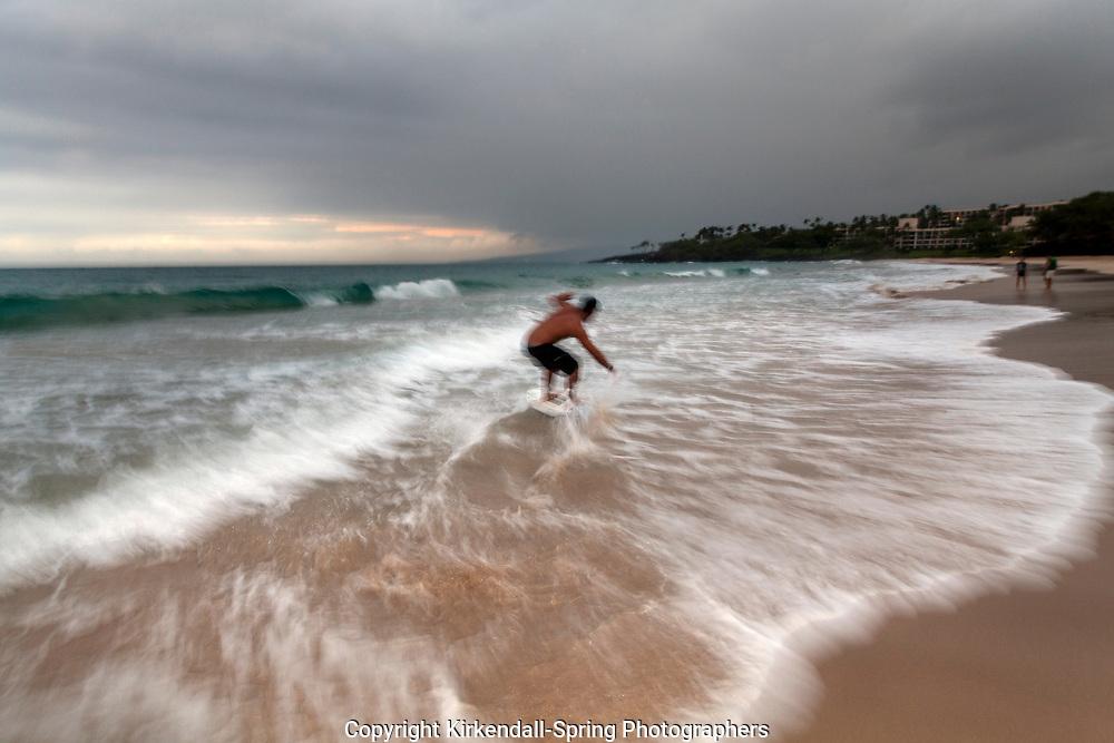 HI00402-00...HAWAI'I - Kaleo Carpio skim boarding at Hapuna Beach State Recreation Area on the island of Hawai'i. (MR# C14)