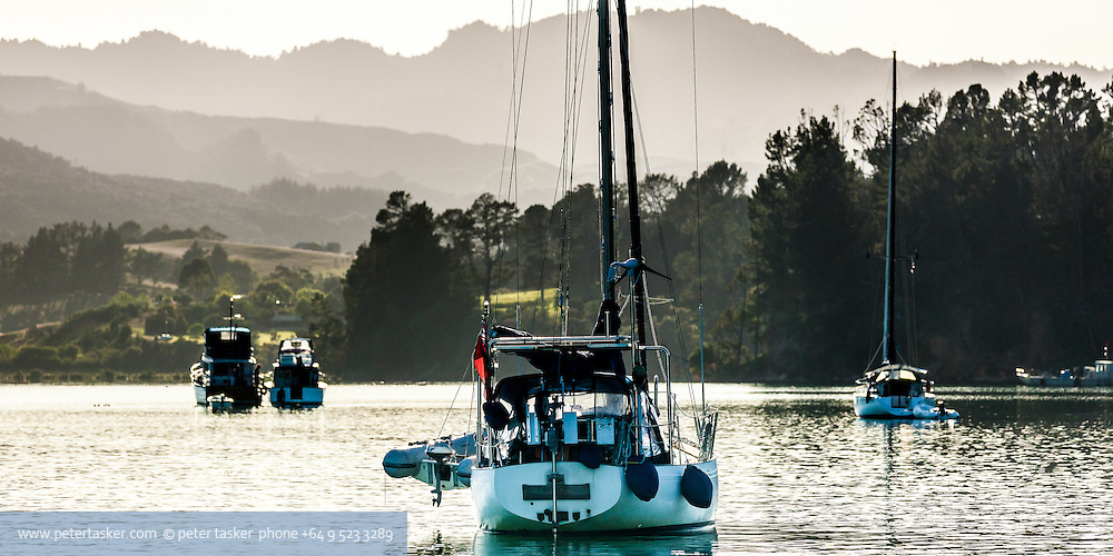 Yacht, Pacific Voyager, at anchor in Te Kouma Harbour, Coromandel Peninsula, New Zealand.