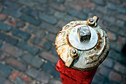 High angle view of a red and white fire hydrant.