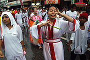 Heavy rain forces the river to flood Phuket Town drenching the participants of Phuket's Vegetarian Festival, Thailand October 2003..©David Dare Parker/AsiaWorks Photography