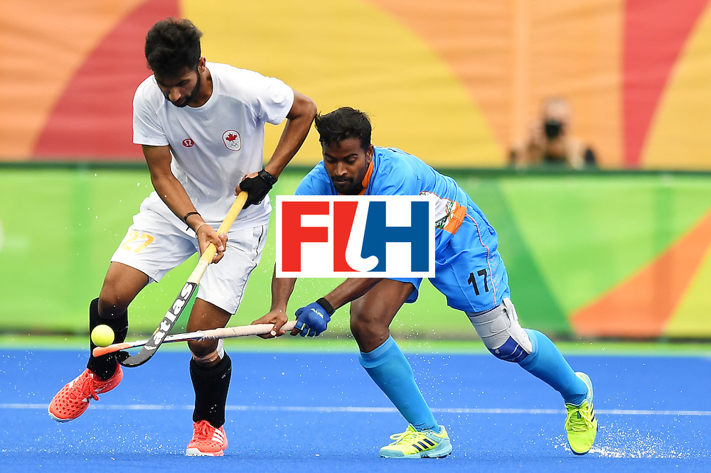 India's Danish Mujtaba (R) and Canada's Sukhi Panesar vie during the mens's field hockey India vs Canada match of the Rio 2016 Olympics Games at the Olympic Hockey Centre in Rio de Janeiro on August, 12 2016. / AFP / MANAN VATSYAYANA        (Photo credit should read MANAN VATSYAYANA/AFP/Getty Images)