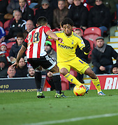 Nottingham Forest striker Ryan Mendes trying to take on Brentford defender Nico Yennaris during the Sky Bet Championship match between Brentford and Nottingham Forest at Griffin Park, London, England on 21 November 2015. Photo by Matthew Redman.