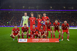 CARDIFF, WALES - Sunday, October 13, 2019: Wales players line-up for a team group photograph before the UEFA Euro 2020 Qualifying Group E match between Wales and Croatia at the Cardiff City Stadium. Back row L-R: goalkeeper Wayne Hennessey, Joe Rodon, Ethan Ampadu, Kieffer Moore. Front row L-R: Daniel James, Connor Roberts, captain Gareth Bale, Joe Allen, Ben Davies, Tom Lockyer, Jonathan Williams. (Pic by David Rawcliffe/Propaganda)