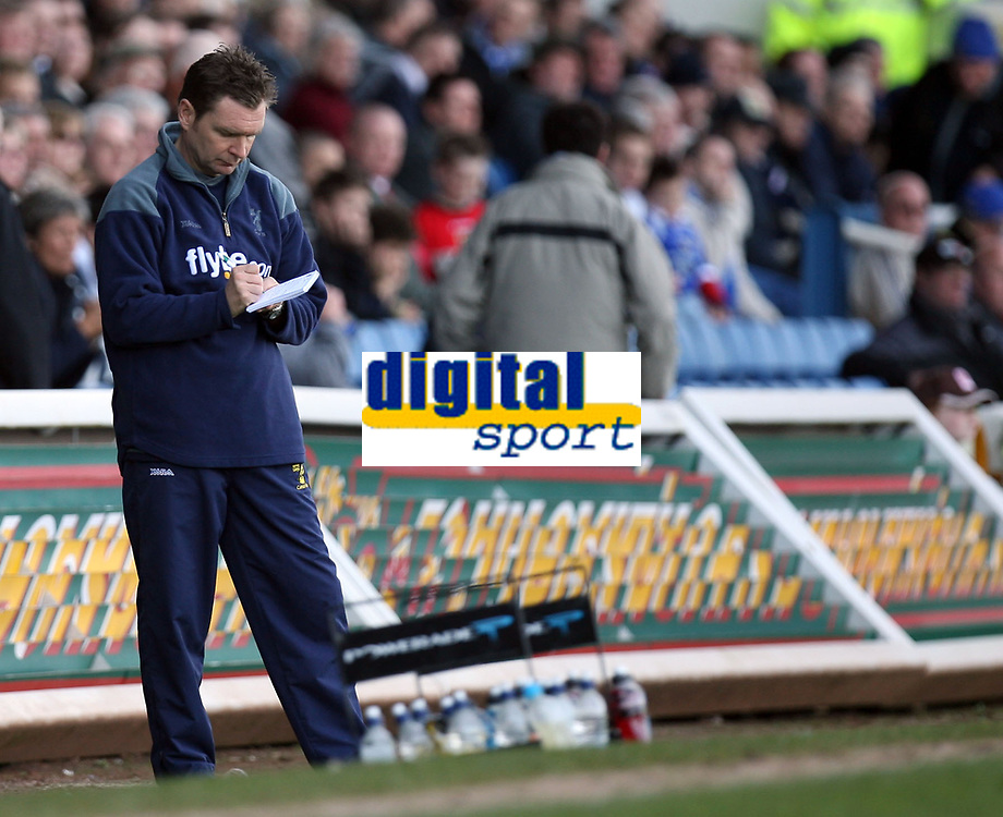 Photo: Rich Eaton.<br /> <br /> Cardiff City v Norwich City. Coca Cola Championship. 10/03/2007. Norwich manager Peter Grant makes notes during his teams 1-0 defeat away at Cardiff