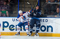 PENTICTON, CANADA - SEPTEMBER 9: Chad Butcher #65 of Edmonton Oilers checks Antoine Crete-Belzile #72 of Winnipeg Jets into the boards during first period on September 9, 2017 at the South Okanagan Event Centre in Penticton, British Columbia, Canada.  (Photo by Marissa Baecker/Shoot the Breeze)  *** Local Caption ***
