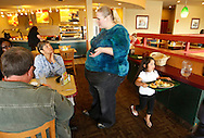 Gabi Jones talks to other patrons out for lunch at Sooper Salad in Denver April 16, 2010.  Jones (not her real name) at 502 pounds wants to change society's views on people of her size and their eating habits saying most large people are just born with their size and eat healthy foods in appropriate quantities but still stay fat.  REUTERS/Rick Wilking  (UNITED STATES)