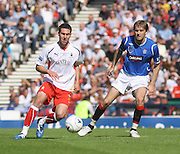 Carl Finnigan and Sasa Papac during the Homecoming Scottish FA Cup Final between Falkirk and Rangers at Hampden Park (picture by David Young - 07765 252616)