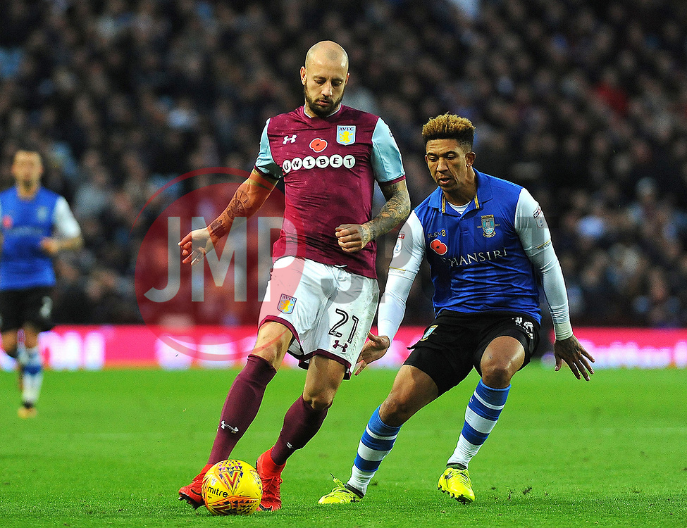 Liam Palmer of Sheffield Wednesday applies pressure on Alan Hutton of Aston Villa- Mandatory by-line: Nizaam/Jones - 04/11/2017 - FOOTBALL - Villa Park - Birmingham, England - Aston Villa v Sheffield Wednesday - Sky Bet Championship