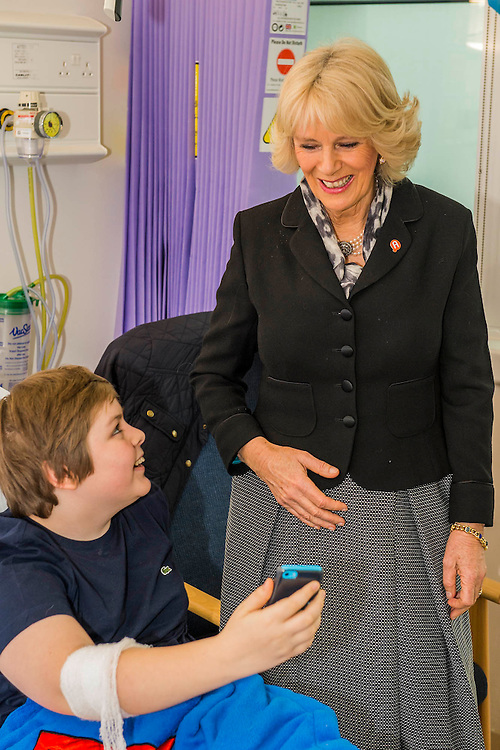 Her Royal Highness meets Charley Saunders, 18 from Poplar, and Danny Roberts, 13 from Maida Vale (pictured taking a selfie with her), on the ward. The Duchess of Cornwall, Patron, Arthritis Research UK, visits and meets patients of the Adolescent Inpatient Unit at University College London Hospitals.  •	Her Royal Highness then tours a laboratory at the Arthritis Research UK Centre for Adolescent Rheumatology and meeting researchers and supporters. London 12 Feb 2015.