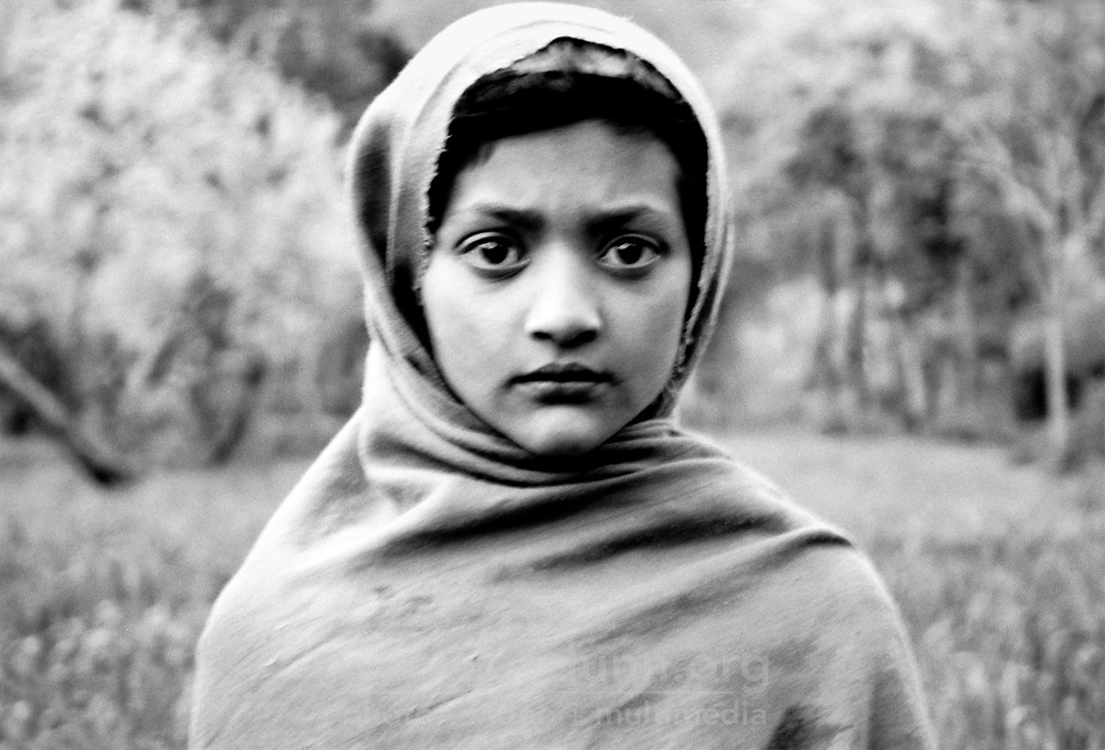 Pakistan, Northwest Frontier Province, Chitral, 2004. A waking dream, or only an expression. In a young Chitrali girl's eyes, past and future side by side.