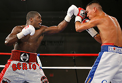 July 27, 2007; Saratoga Springs, NY, USA; Andre Berto (White/Red Trunks) trades punches with Cosme Rivera (White/Blue Trunks) during their 10 round bout at the Saratoga Springs City Center.  Berto won via 10 round unanimous decision.