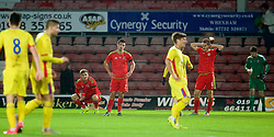 WREXHAM, WALES - Tuesday, November 17, 2015: Wales' Lee Evans, Liam Shephard and Thomas Lockyer look dejected as they draw 1-1 with 10-man Romania during the UEFA Under-21 Championship Qualifying Group 5 match at the Racecourse Ground. (Pic by David Rawcliffe/Propaganda)