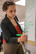 Purchase, NY – 31 October 2014. Naira Luke-­Aleman of Yonkers Montessori writing presentation notes for her team. The Business Skills Olympics was founded by the African American Men of Westchester, is sponsored and facilitated by Morgan Stanley, and is open to high school teams in Westchester County.