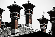 The symmetry of the chimneys on this rooftop in Como caught my eye.