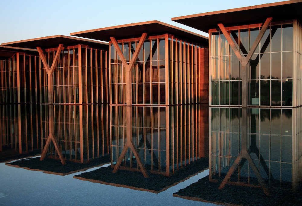 Concrete structure captured at sunrise and reflected in pool at the Ft. Worth Modern Art Museum.