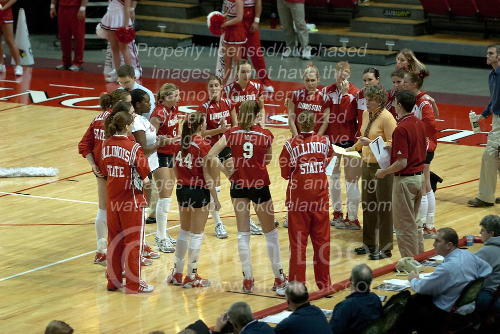 20 November 2004....ISU Head Coach Sharon Dingman addresses her team before the start of the match....Illinois State University Redbirds V Drake Bulldogs Women's Volleyball.  Redbird Arena, Illinois State University, Normal IL