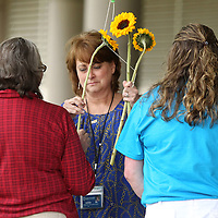 Adam Robison | BUY AT PHOTOS.DJOURNAL.COM<br /> Karen George, RN with the North Mississippi Medical Center, hand sunflowers for donor families at the Donate Life event a the North Mississippi Medical Center Tuesday morning in Tupelo.