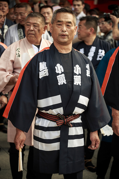A traditionally dressed participant at Sanja Matsuri. Sanja Matsur (Three Shrine Festival), is an annual Shinto festival held in Tokyo. The earliest form of the festivals dates back to the 7th century CE and is held in honor of Hinokuma Hamanari, Hinokuma Takenari and Hajino Nakatomo, the three men who established and founded Sensō-ji temple. Sanja Matsuri is held on the third weekend of every May at Asakusa Shrine. Its  parades revolve around three mikoshi (three portable shrines referenced in the festival's name), as well as traditional music and dancing.