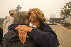 October 10, 2017 - Santa Rosa, California, U.S. - KIM GRAVES, left, hugs her neighbor SUSAN GAYNARD after they both lost homes in 1North Rincon Valley during a wildfire in Sonoma County in Santa Rosa, Calif. (Credit Image: © Paul Kitagaki Jr/Sacramento Bee via ZUMA Wire)