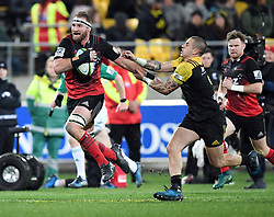 Crusaders Kieran Read, left, fends off Hurricanes TJ Perenara in Super Rugby match at Westpac Stadium, Wellington, New Zealand, Saturday, July 15, 2017. Credit:SNPA / Ross Setford  **NO ARCHIVING""