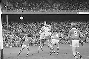 A group of players all jump high waiting to gain possession of the ball during the All Ireland Minor Gaelic Football Final, Tyrone v Kerry in Croke Park on the 28th September 1975.