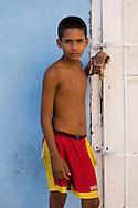 A young Cuban boy with a baseball mitt in Trinidad, Cuba