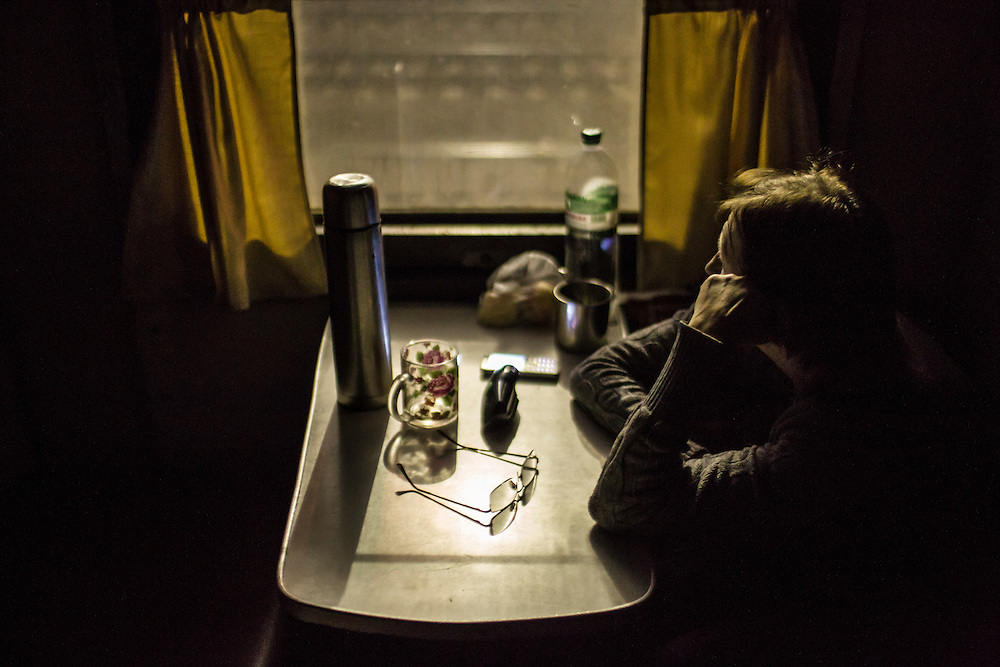 SLOVYANSK, UKRAINE - FEBRUARY 7, 2015: A woman displaced by fighting in the town of Debaltseve sits inside a train in which she is being temporarily housed in Slovyansk, Ukraine. Many civilians have been evacuated from Debaltseve and brought to Slovyansk, where they are either given a free onward ticket or housed in the train or another facility until they can make further plans. CREDIT: Brendan Hoffman for The New York Times