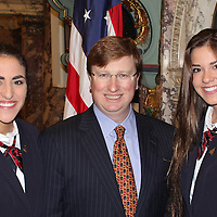 PAGES AT STATE CAPITOL<br /> (Courtesy Photo)<br /> Holly and Millie Hudson, of Woodland, recently served as pages for the Mississippi Senate running errands for officials and Senate staff.  They are shown Lt. Governor Tate Reeves who sponsored their visit.  Holly and Millie are the daughters of David and Talitha Hudson and attend Hebron Christian School.