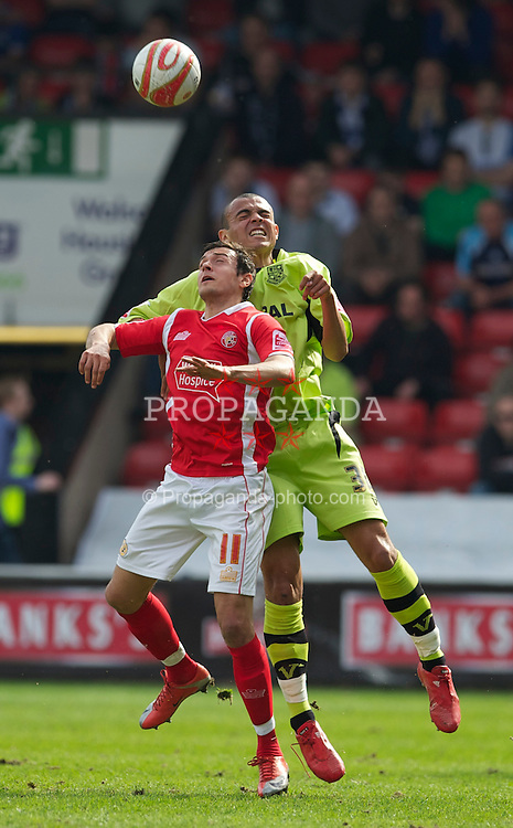 WALSALL, ENGLAND - Saturday, April 10, 2010: Walsall's Alex Nicholls and Tranmere Rovers' Ben Gordon during the Football League One match at the Bescot Stadium. (Photo by David Rawcliffe/Propaganda)