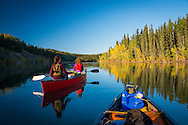 Yukon Territory, Canada, September 2014. two paddlers in a canoe at Lower Laberge. During this Yukon River canoe trip we paddled part of the Klondike Gold Rush route of 1898. We camped on the banks of the Yukon River in authentic northern wilderness and explored the gold rush relics on the way. Photo by Frits Meyst / MeystPhoto.com