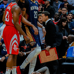 Jan 26, 2018; New Orleans, LA, USA; New Orleans Pelicans forward Anthony Davis (23) and Houston Rockets guard James Harden (13) check on center DeMarcus Cousins (floor) after he sustained an injury during the fourth quarter at the Smoothie King Center. Pelicans defeated the Rockets 115-113. Mandatory Credit: Derick E. Hingle-USA TODAY Sports