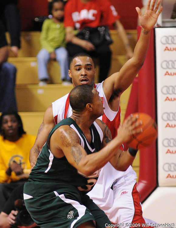 Mar 7, 2009; Piscataway, NJ, USA; Rutgers forward Jaron Griffin (32) defends South Florida guard Chris Howard (3) during the first half of Rutgers' senior day game against South Florida at the Louis Brown Athletic Center.  Rutgers won 45-42.