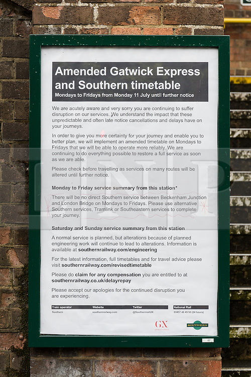 © Licensed to London News Pictures. 12/07/2016. LONDON, UK.  A sign outside Birkbeck station notifying passengers that there are no Southern Rail trains to London Bridge. Southern Rail have introduced an emergency timetable and cancelled many services, including all trains to London Bridge from Birkbeck station in zone 4. A tram service to East Croydon station is still running from Birkbeck station.  Commuters staged a protest against delayed, cancelled and overcrowded Southern Rail train services last night at Victoria Station in London. Photo credit: Vickie Flores/LNP