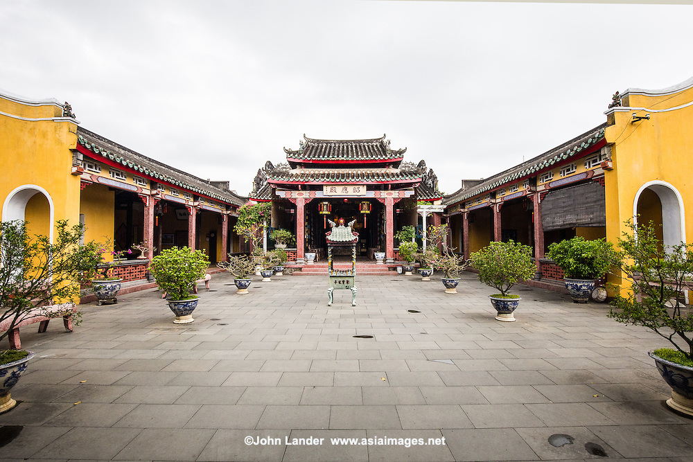 Hainan Assembly Hall or Hoi Quan Hai Nam - was built by the overseas Chinese from Hainan Province who lived in Hoi An.  Their assembly hall is used to worship Chinese merchants who were falsely accused of being pirates, later they were named as deities by Vietnamese king Tu Duc who donated money and resources to have this assembly hall built for the sake of restoring their names and as a place for ancestor worship. One of the more intricate of architectural masterpieces in UNESCO Hoi An, visitors pass through a courtyard of ornamental trees, to the main hall dedicated to the Hainan Chinese killed at sea.  The God of Wealth is worshipped on the right.