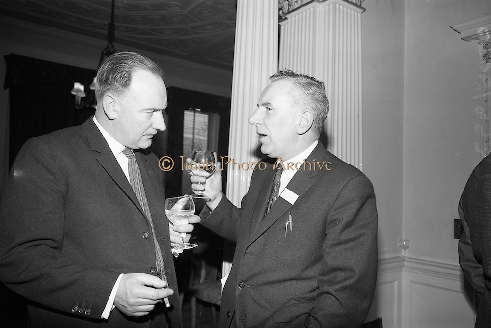 05/05/1965<br /> 05/05/1965<br /> 05 May 1965<br /> Thomas Heiton and Co. Ltd. Reception  to promote stainless steel in manufacturing at the Shelbourne Hotel, Dublin. Pictured at the reception were (l-r): Mr. D.J. Ward, Purchasing Officer, H.A. O'Neill Ltd. and Mr. C.W. Barry, Sales Rep for Thomas Heiton and Co.. Thomas Heiton and Co. were agents for steel produced by Samuel Fox and Co. Ltd., Sheffield, England.