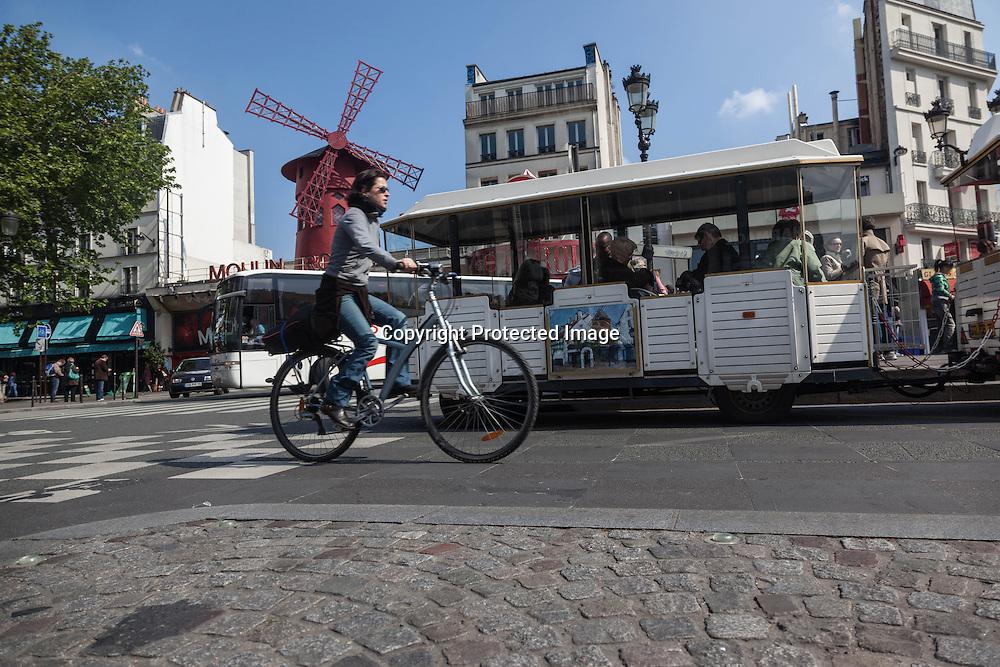 France.  Paris 9th district.  Place Pigalle , le moulin rouge, and the small train of the butte Montmartre  / Paris Place pigalle, le petit train de la butte