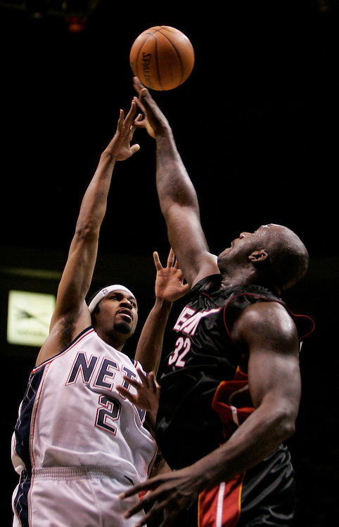 New Jersey Nets Rodney Buford shoots over Miami Heat Shaquille O'Neal in the opening game of the season at the Continental Airlines Arena in East Rutherford New Jersey Wednesday 03 November 2004.  EPA/ANDREW GOMBERT