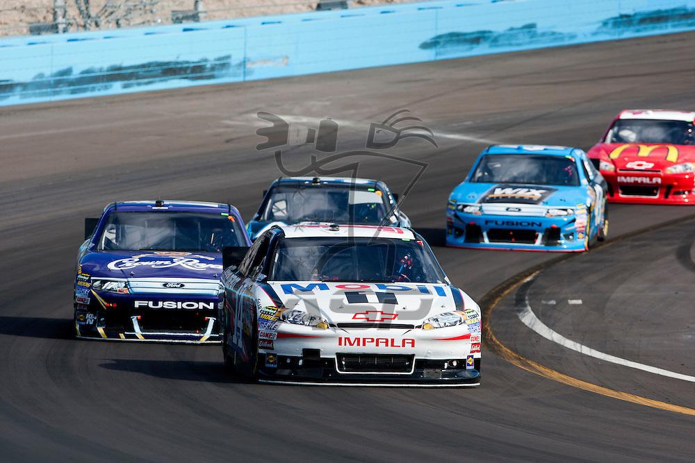 Avondale, AZ - NOV 13, 2011:  Matt Kenseth (17) and Tony Stewart (14)  race for the Kobalt Tools 500 race at the Phoenix International Raceway in Avondale, AZ.