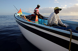 MAURITIUS BLACK RIVER 2MAY13 - Artisanal fishermen Joyce Seetah and Herve Colfire work in their boat in Black Rivery Bay, Mauritius.<br /> <br /> <br /> <br /> Coastal fishing is in decline due to large, industrial foreign fishing fleets operating in Mauritian waters.<br /> <br /> The Greenpeace ship Esperanza is on patrol in the Indian Ocean documenting fishing activties.<br /> <br /> <br /> <br /> jre/Photo by Jiri Rezac / Greenpeace