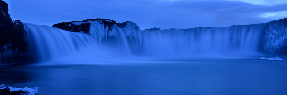 The waterfall Godafoss at dusk in blue light in wintertime, Iceland
