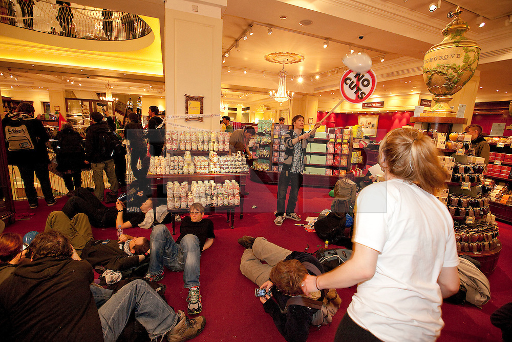 "© under license to London News Pictures. 25/03/2011: UKUncut protesters occupy Fortnum and Mason in Piccadilly during a day of anticuts protests across London. Protesters say the owners of the business avoid £10 million in corporation tax every year as they are registered offshore in Luxemburg. Credit should read ""Joel Goodman/London News Pictures""."
