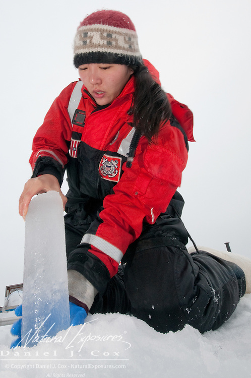Brenna McConnell hauls an ice core sample from a recetnly drilled hole.