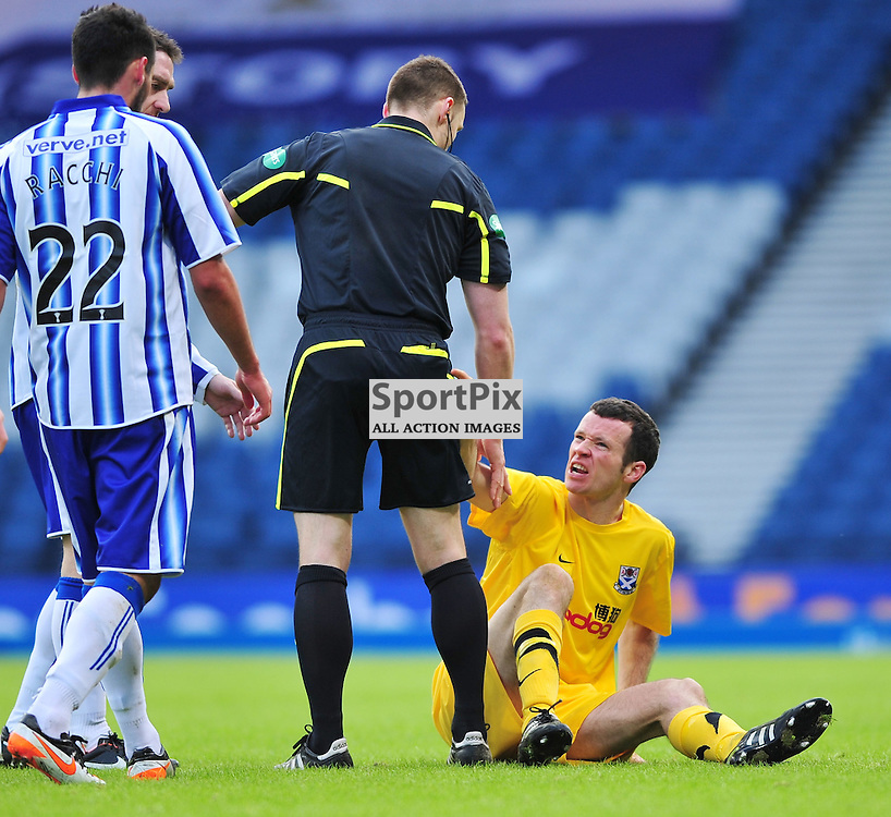 Eddie Malone (Ayr, yellow) shows his disgust at a tackle by Danny Racchi (Kilmarnock, 22)