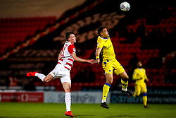 Jonson Clarke-Harris of Bristol Rovers beats Paul Downing of Doncaster Rovers to the ball - Mandatory by-line: Robbie Stephenson/JMP - 26/03/2019 - FOOTBALL - Keepmoat Stadium - Doncaster, England - Doncaster Rovers v Bristol Rovers - Sky Bet League One