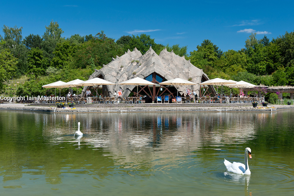 Lake and cafe at Britzer Garden in Neukolln district Berlin Germany